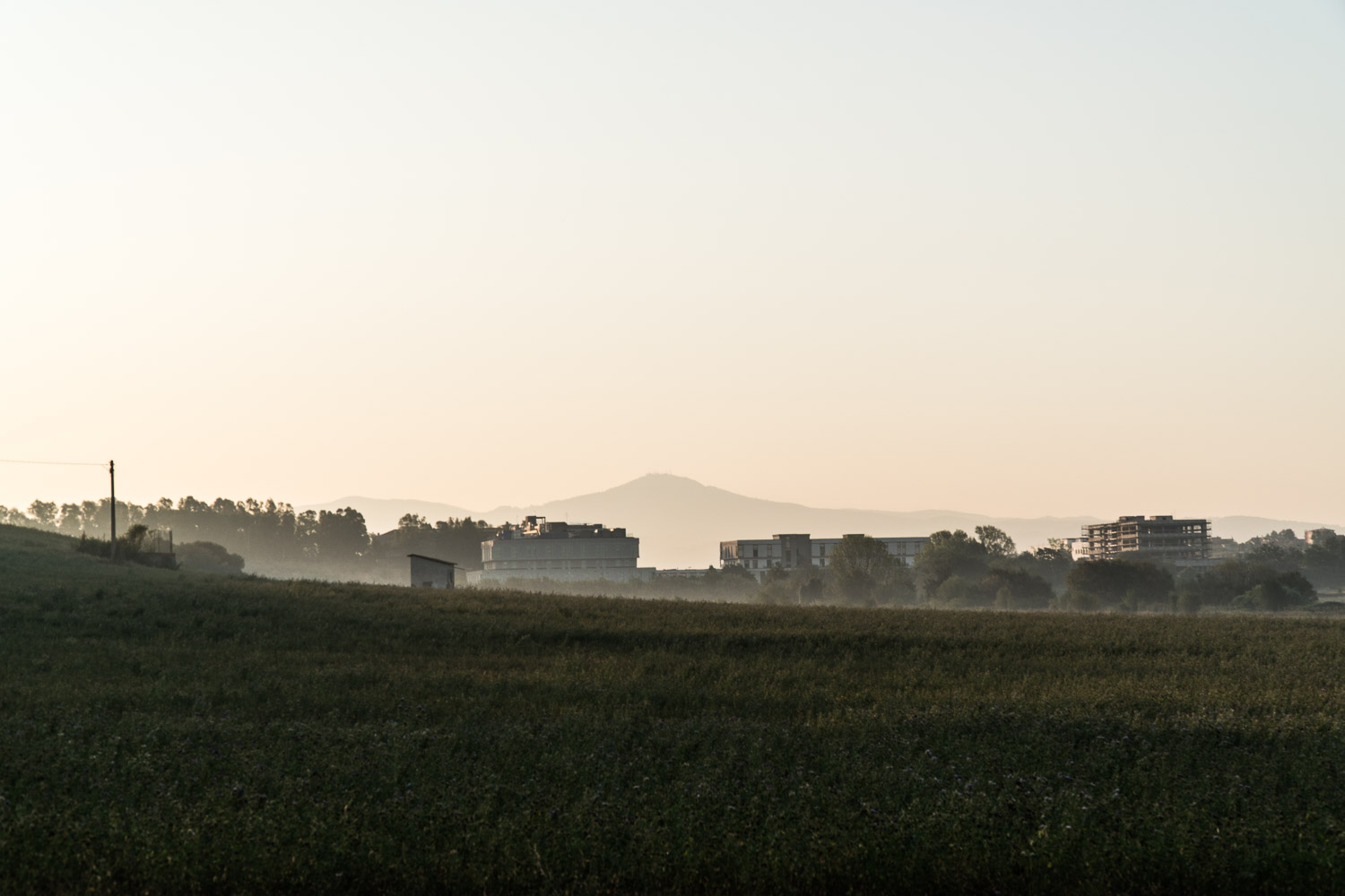 Monte Cavo rises from the mist of the dawn and the Roman suburbs housing